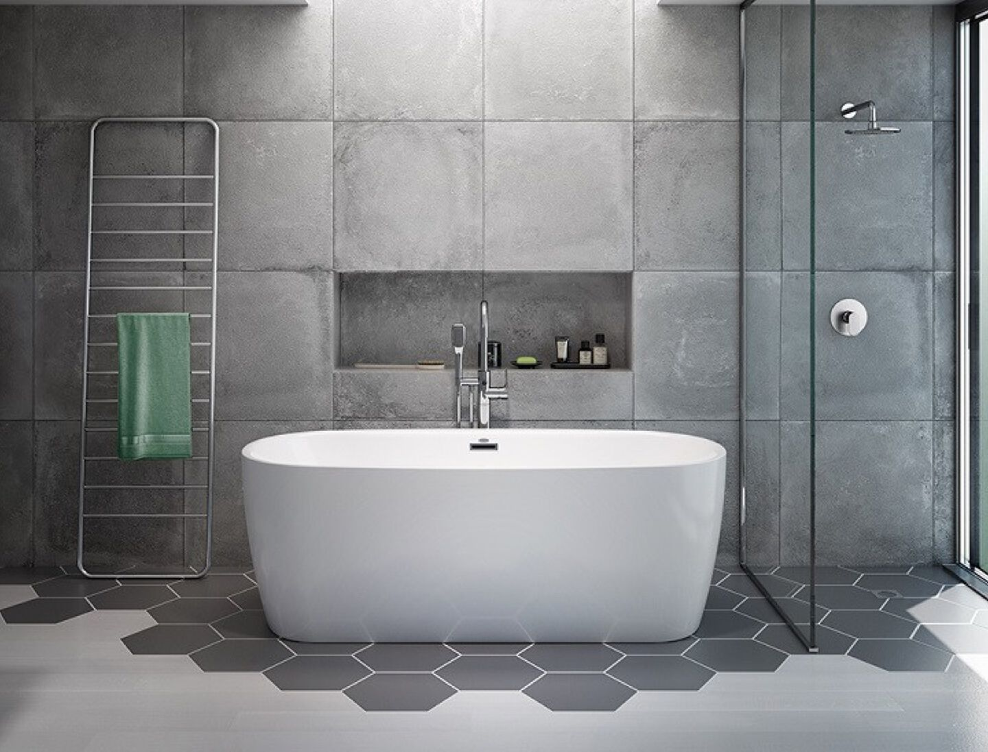 free-standing bath tub on grey hex tiles